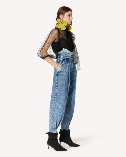 礼服蝴蝶结细节大理石纹牛仔裤